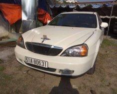 Chính chủ bán xe Daewoo Magnus 2.0 limited sản xuất năm 2005, màu trắng giá 150 triệu tại Tp.HCM