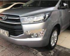 Cần bán xe Toyota Innova 2.0E 2016, màu bạc như mới giá 695 triệu tại Hà Nội