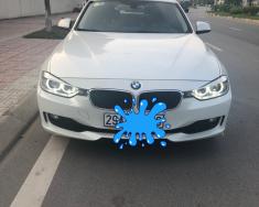 Bán xe BMW 3 Series sản xuất 2013 màu trắng, 880 triệu, nhập khẩu nguyên chiếc giá 880 triệu tại Hà Nội