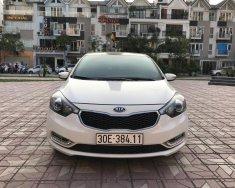 Bán xe Kia K3 2.0AT đời 2014, màu trắng giá 558 triệu tại Hà Nội