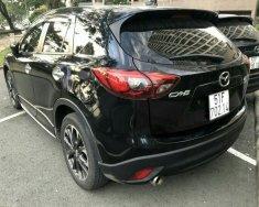 Bán Mazda CX-5 Facelift 2.0AT màu đen, số tự động sản xuất 2016 biển Sài Gòn, lăn bánh 36000km giá 796 triệu tại Tp.HCM