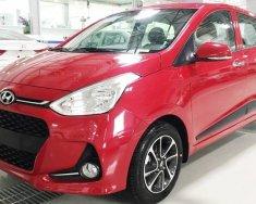 Hyundai Grand i10 số tự động màu đỏ giao ngay trước tết, gía KM kèm quà tặng hấp dẫn, hỗ trợ vay lãi suất ưu đãi. LH: 0903175312 giá 405 triệu tại Tp.HCM