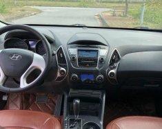 Cần tiền mua đất nên bán xe Hyundai Tucson 2.0 AT 4WD đời 2013, màu trắng, nhập khẩu nguyên chiếc chính chủ, 599tr giá 599 triệu tại Hà Nội