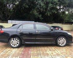 Cần bán xe Toyota Altis 2.0V màu đen số tự động, xe chính chủ giá 460 triệu tại Hà Nội