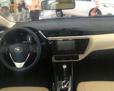 Cần bán xe Toyota Corolla Altis 1.8G đời 2018, màu trắng, hỗ trợ trả góp 85% giá 766 triệu tại Tp.HCM