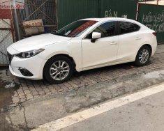 Bán Mazda 3 1.5 AT 2015, màu trắng, chính chủ giá 590 triệu tại Hà Nội