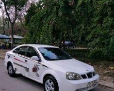Bán Daewoo Lacetti năm 2004, màu trắng giá cạnh tranh giá 129 triệu tại Hà Nội