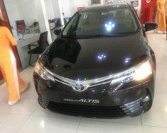 Bán Toyota Corolla Altis 1.8E MT số sàn năm sản xuất 2018, màu đen giá 672 triệu tại Tp.HCM