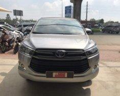 Cần bán xe Toyota Innova E 2018, màu bạc giá 780 triệu tại Tp.HCM