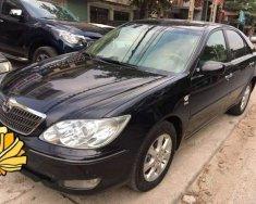 Cần bán xe Toyota Camry năm 2004, màu đen giá 380 triệu tại Tp.HCM