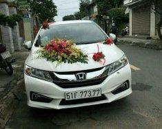 Căn bán gấp 1 xe Honda City màu trắng, cuối đời 2016, số tự động giá 575 triệu tại Tp.HCM