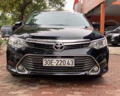 Cần bán xe Toyota Camry 2.0E đời 2016, màu đen giá cạnh tranh giá 899 triệu tại Hà Nội