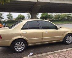 Bán ô tô Ford Laser GHIA 1.8 AT đời 2004, màu vàng, 230 triệu giá 230 triệu tại Hà Nội