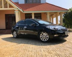Cần bán lại xe Kia K3 1.6 MT năm sản xuất 2015, màu đen số sàn, giá tốt giá 465 triệu tại Hòa Bình