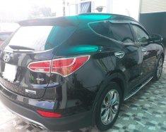 Bán Hyundai Santafe 2015, full xăng, màu đen, đúng chất, giá TL, hỗ trợ góp giá 908 triệu tại Tp.HCM
