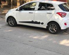 Bán Hyundai Grand i10 1.0 MT Base 2015, màu trắng, nhập khẩu, gia đình sử dụng giá 266 triệu tại Hà Nội