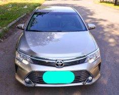Bán xe Toyota Camry 2.5Q 2015 màu vàng cát/đen giá 1 tỷ 65 tr tại Tp.HCM
