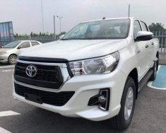 Bán xe Toyota Hilux sản xuất năm 2018, màu trắng, xe nhập giá 695 triệu tại Tp.HCM