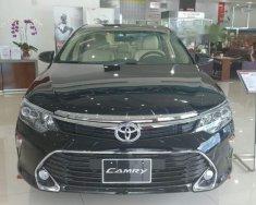 Cần bán Toyota Camry 2.0E sản xuất 2018, màu đen giá cạnh tranh giá 972 triệu tại Tp.HCM
