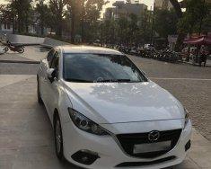 Xe gia đình cần bán Mazda 3 1.5 AT năm sản xuất 2015, màu trắng giá 575 triệu tại Hà Nội