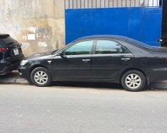 Gia đình cần bán xe Camry 2003, số sàn, màu đen, xe còn mới tinh giá 328 triệu tại Tp.HCM