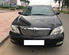 Bán Toyota Camry 3.0V sản xuất 2004, màu đen như mới giá 345 triệu tại Tp.HCM