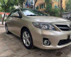 Bán lại chiếc Toyota Corolla Altis AT 2.0, Đk 2012 màu vàng cát giá 555 triệu tại Hà Nội