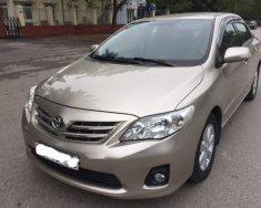 Chính chủ bán Toyota Corolla altis 1.8G đời 2011, màu vàng giá 555 triệu tại Hà Nội