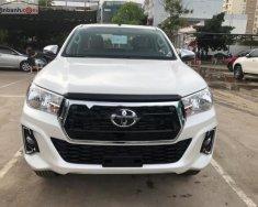 Cần bán xe Toyota Hilux 2.4E 4x2 AT đời 2019, màu trắng, nhập khẩu  giá 695 triệu tại Tp.HCM