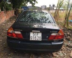 Cần bán xe Mitsubishi Lancer sản xuất 2001, màu đen, nhập khẩu giá 155 triệu tại Tp.HCM