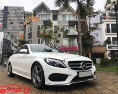Bán Mercedes C300 AMG model 2016, màu trắng nội thất đỏ cá tính, full options giá 1 tỷ 560 tr tại Hà Nội