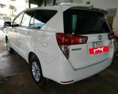 Đổi xe cần bán Innova 2017 2.0E màu trắng, new 95% 1 chủ giá 718 triệu tại Tp.HCM