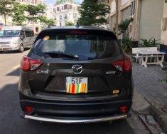 Cần bán xe Mazda CX 5 sản xuất 2015, màu nâu xe gia đình giá cạnh tranh giá 740 triệu tại Tp.HCM