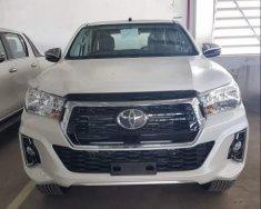 Bán Toyota Hilux đời 2018, màu trắng, xe nhập giá 695 triệu tại Tp.HCM