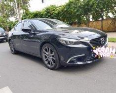 Cần bán lại xe Mazda 6 2.0 AT sản xuất năm 2017, màu đen giá 855 triệu tại Tp.HCM