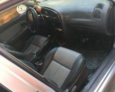 Cần bán lại xe Kia Spectra 2004, màu bạc chính chủ, 115tr giá 115 triệu tại Tp.HCM