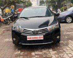 Bán Toyota Corolla altis 1.8AT đời 2016, màu đen số tự động giá 699 triệu tại Hà Nội