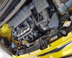 Cần bán xe Kia Morning sản xuất 2014, màu vàng chính chủ giá 230 triệu tại Tp.HCM