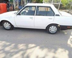 Cần bán lại xe Toyota Corolla năm sản xuất 1986, màu trắng, nhập khẩu nguyên chiếc, giá 50tr giá 50 triệu tại Bình Dương