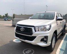 Bán Toyota Hilux 2.4G AT (4X2), màu trắng giá cạnh tranh, khuyến mãi lớn giá 703 triệu tại Tp.HCM
