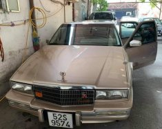 Gia đình bán Cadillac STS Seville V8 4.5 đời 1990, màu vàng, nhập khẩu nguyên chiếc giá 255 triệu tại Tp.HCM