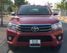 Chính chủ bán xe Toyota Hilux 2.4E 2016, màu đỏ, xe nhập giá 575 triệu tại Đồng Nai