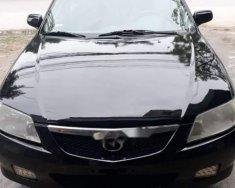 Cần bán Mazda 323 đời 2002, màu đen, xe đẹp nguyên bản giá 125 triệu tại Nghệ An