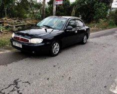 Bán Kia Spectra sản xuất năm 2004, màu đen xe gia đình giá 92 triệu tại Nghệ An
