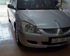 Cần bán lại xe Mitsubishi Lancer 2004, màu bạc số tự động, giá tốt giá 215 triệu tại Lâm Đồng