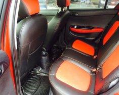 Bán xe Hyundai I20 đời 2010, số tự động, màu đỏ, nhập Ấn Độ giá 335 triệu tại Tp.HCM