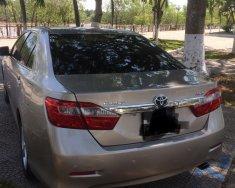 Bán xe Toyota Camry 2.5 Q năm 2014, màu vàng cát giá 890 triệu tại Bến Tre