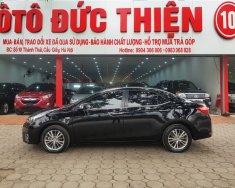 Bán Toyota Corolla Altis 1.8G AT sản xuất năm 2014, màu đen, 655 triệu giá 655 triệu tại Hà Nội
