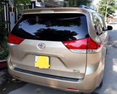 Bán xe Toyota Sienna LE 3.5 đời 2010, màu vàng, nhập khẩu nguyên chiếc như mới giá 1 tỷ 390 tr tại Tp.HCM