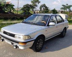 Bán ô tô Toyota Corolla 1.3 MT đời 1991, màu bạc giá 95 triệu tại Tp.HCM